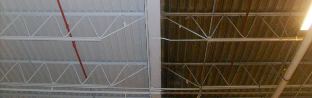 painting a bar joist ceiling in chicago 1 1024x323 Warehouse Painting